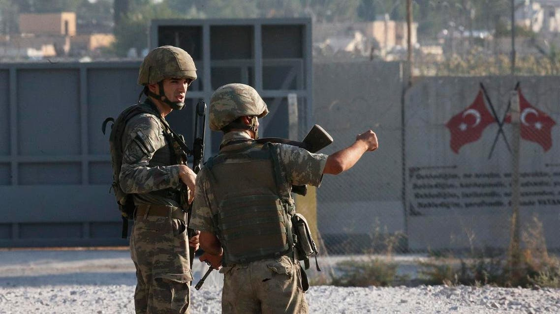 Turkish soldiers stand at the border with Syria in Akcakale, Sanliurfa province. (AP)