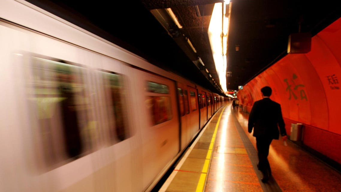 A Hong Kong MTR Metro train arrives at a downtown station Wednesday, Nov. 24, 2004. (AP)