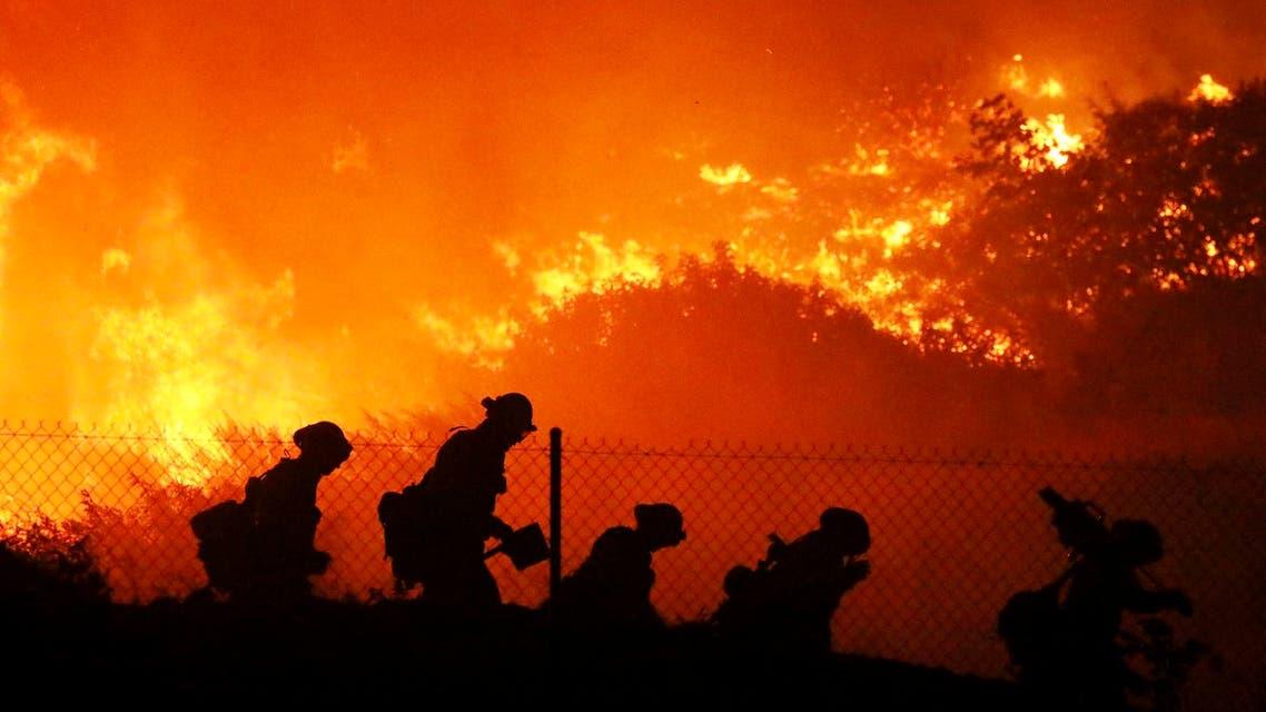 Firefighters battle the Saddleridge fire in Sylmar, Calif., Friday Oct. 11, 2019. (AP Photo)