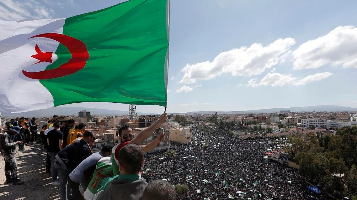 A demonstrator holds an Algerian flag during a protest in Bordj Bou Arreridj, east of Algiers. (AP)