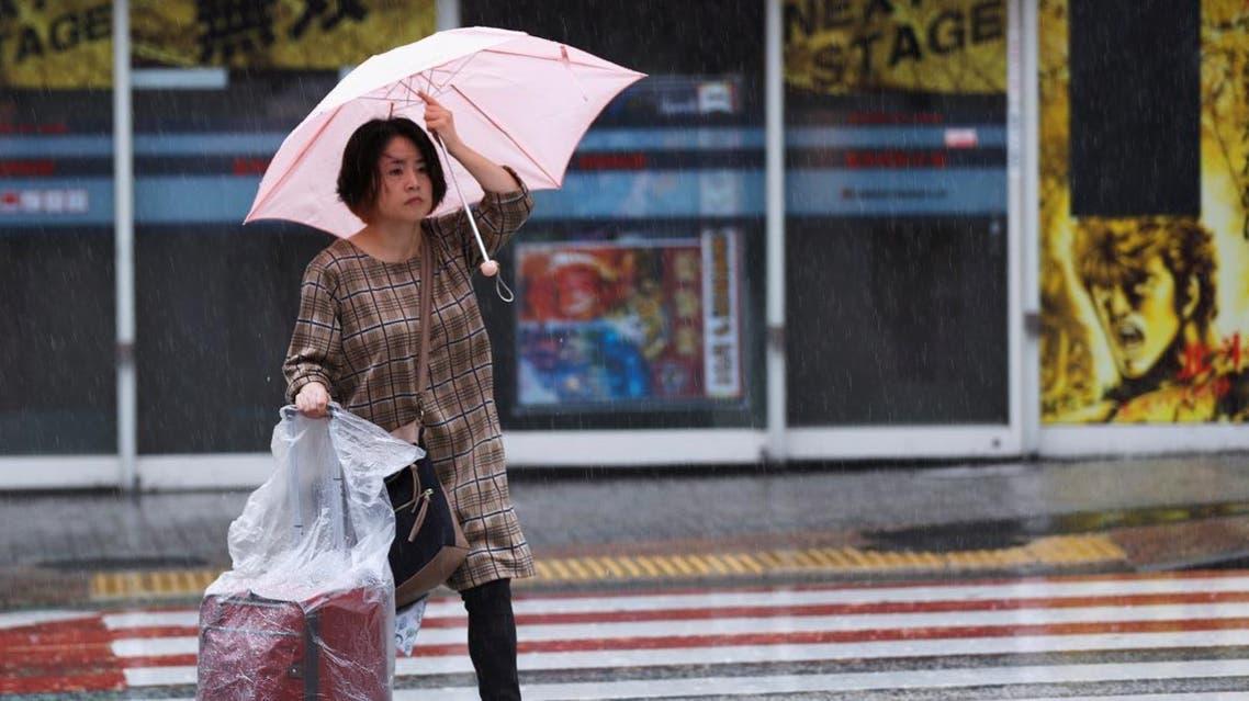 A woman walks in heavy rain ahead of Typhoon Hagibis, in Tokyo, Japan. (Reuters)
