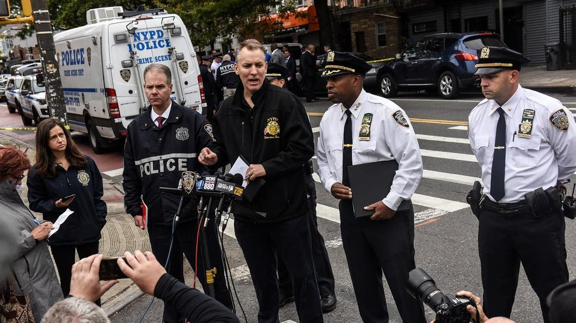 NYPD Chief of Detectives Dermot Shea (C) and NYPD Chief of Patrol Rodney Harrison (R) deliver remarks at a crime scene in front of the Triple A Aces social club on Utica Avenue on October 12, 2019 in New York City. (AFP)