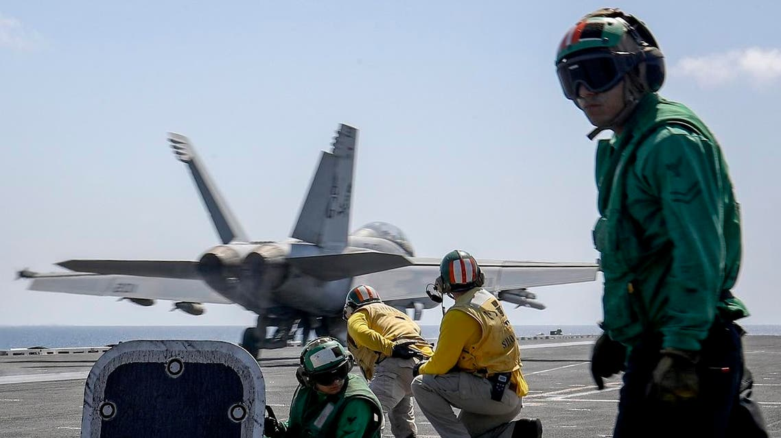 """an F/A-18E Super Hornet from the """"Jolly Rogers"""" of Strike Fighter Squadron (VFA) 103 launches from the flight deck of the Nimitz-class aircraft carrier USS Abraham Lincoln (CVN 72) on Arabian Sea. (File photo: US Navy via AP)"""