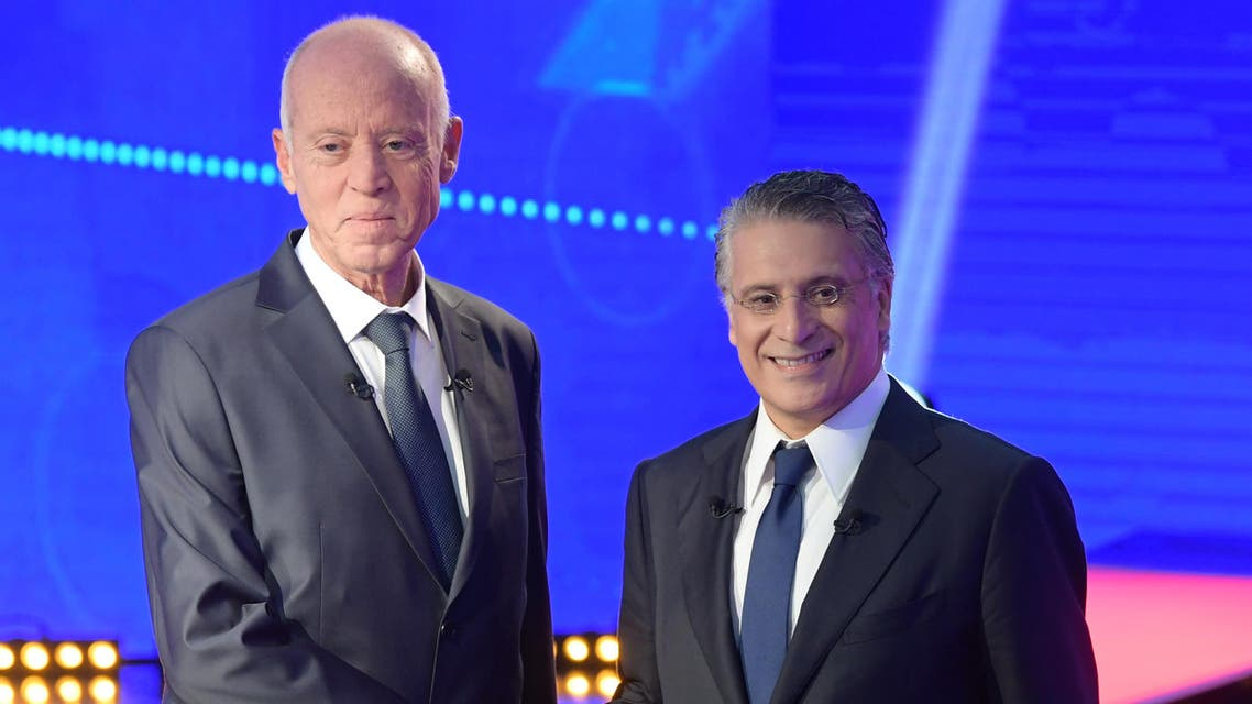 Tunisia's presidential candidates Kais Saied (L), 61, an independent conservative academic, and business tycoon Nabil Karoui (R), 56, attend a debate before the second round of the presidential elections on October 11, 2019 in Tunis. (AFP)