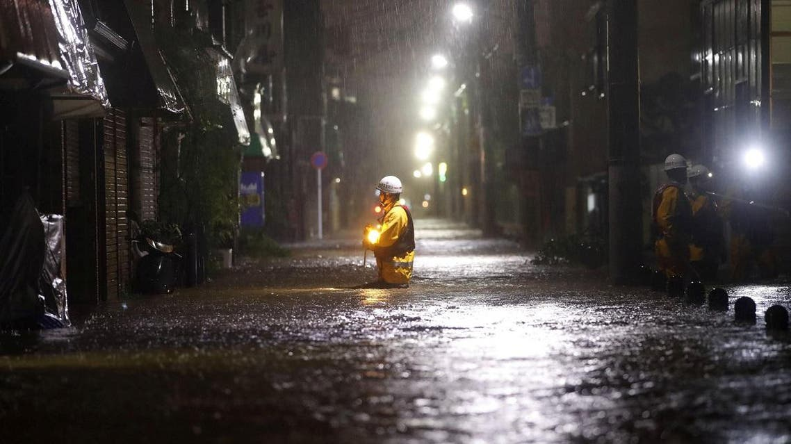Firefighters patrol on a flooded road due to heavy rains caused by Typhoon Hagibis at Ota ward in Tokyo, Japan, October 12, 2019. (Reuters)