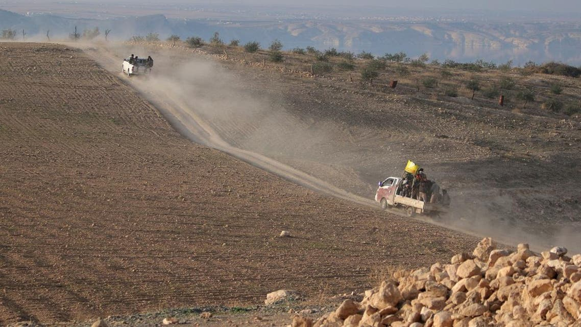 Fighters from the Democratic Forces of Syria head towards their positions during what they said was an offensive against Islamic State militants to take control of Tishrin dam, south of Kobani, Syria December 26, 2015. (Reuters)
