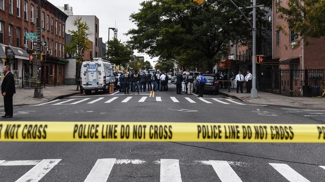 A crime scene is established in front of the Triple A Aces social club on Utica Avenue on October 12, 2019 in New York City. (AFP)