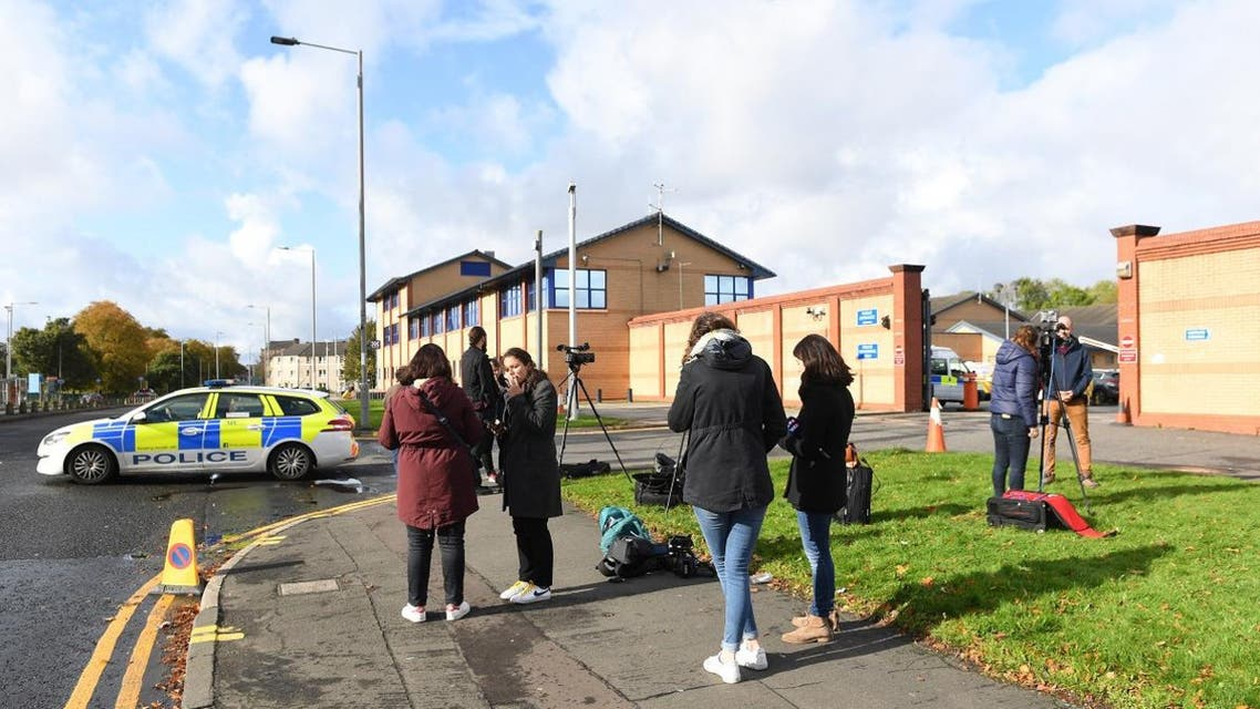 Media report outside Govan Police Station on Helen Street in Glasgow on October 12, 2019 as they await announcement of the identification of a man arrested at Glasgow Airport on October 11 which was reported to be French fugitive Xavier Dupont de Ligonnes. (AFP)