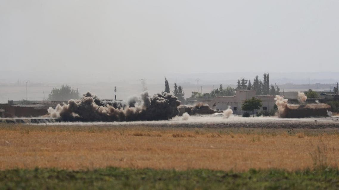 Smoke rises near the border town of Tel Abyad, Syria. (Reuters)