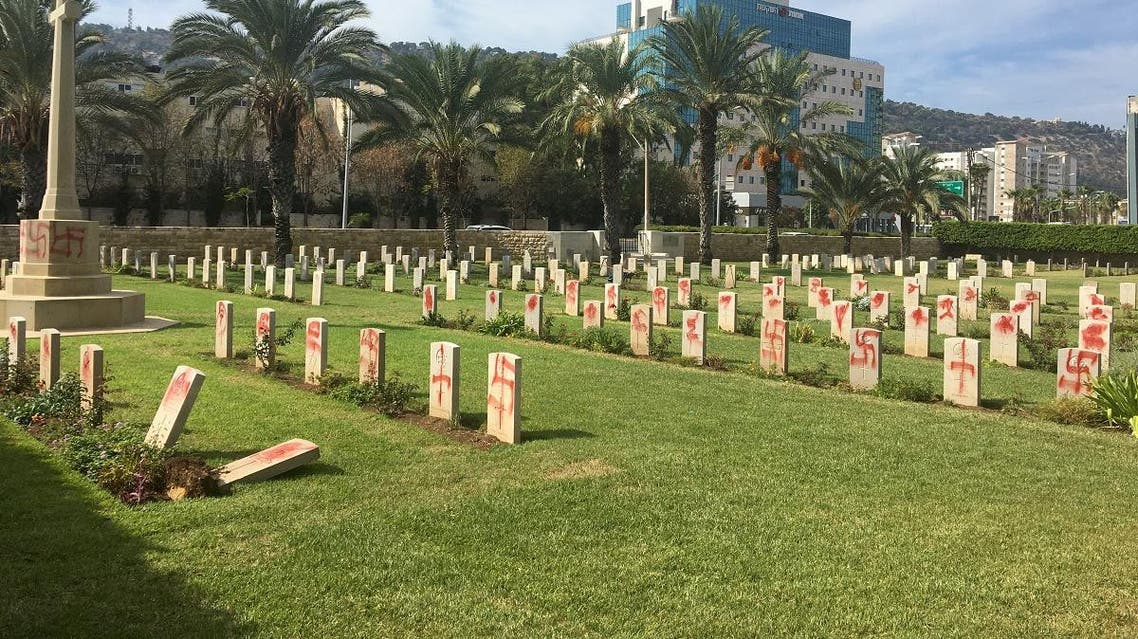 Graffiti of swastikas and other signs can be seen on headstones at the Haifa War Cemetery, where about 350 Commonwealth soldiers killed in World War One and World War Two are buried, Haifa Israel October 11, 2019. (Reuters)