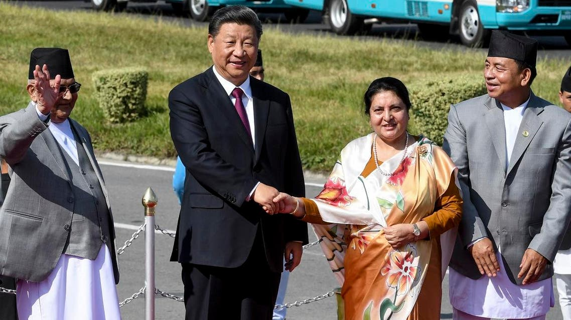 Nepal's President Bidhya Devi Bhandari (2R) and China's President Xi Jinping (2L) shake hands, wrapping up his two-day visit to Nepal, in Kathmandu on October 13, 2019. (AFP)