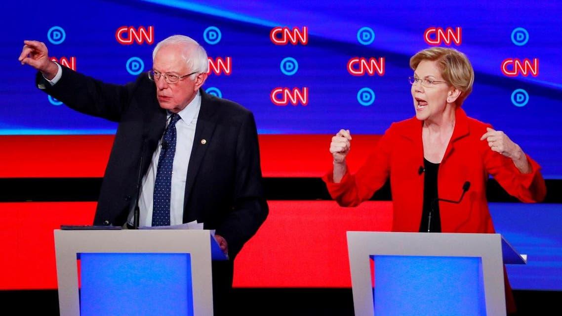 US Senators Sanders and Warren speak on the first night of the second 2020 Democratic US presidential debate in Detroit, Michigan. (File photo: Reuters)