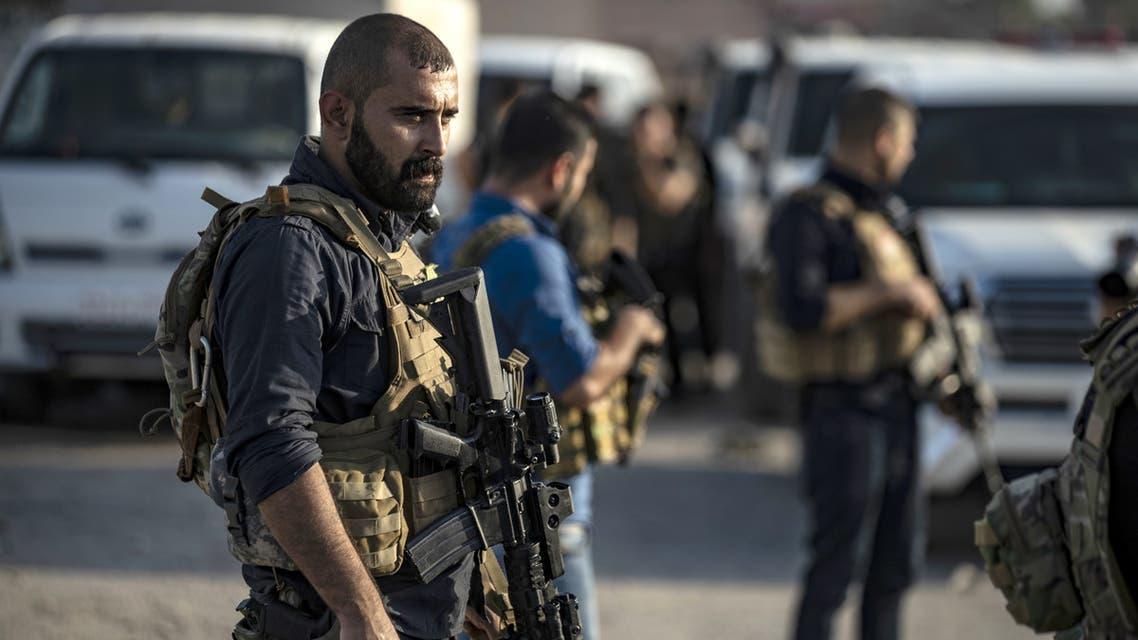 عناصر من قوات سوريا الديمقراطية (فرانس برس)