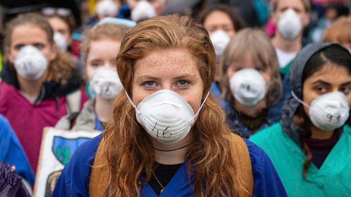 Doctors gather to protest in support of Extinction Rebellion (XR) at Jubilee Gardens, London. (AP)