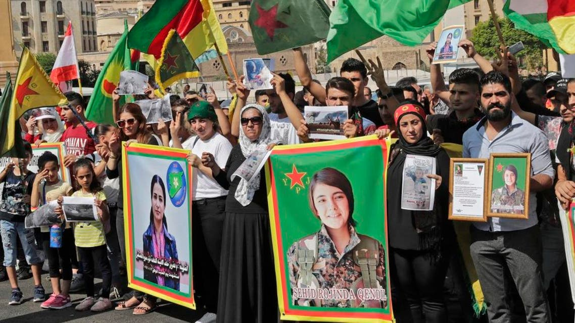 Kurdish protesters wave their national flags and hold photos of Kurdish political leader Hevrin Khalaf (L). (File photo: AFP)