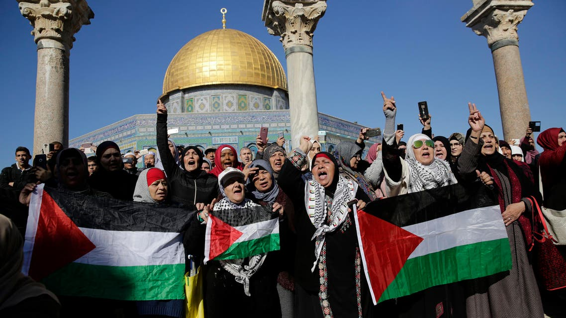 Palestinians protest against U.S. President Donald Trump's decision to recognize Jerusalem as the capital of Israel at the al-Aqsa mosque compound in Jerusalem Friday, (AP)
