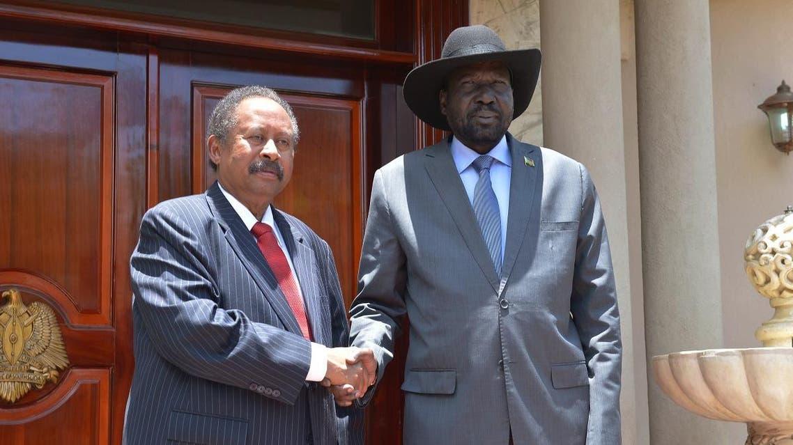 Sudan's prime minister Abdalla Hamdok (L) and South Sudan's President Salva Kiir Mayardit shake hands before meeting on September 12, 2019 in the capital city of Juba. (AFP)