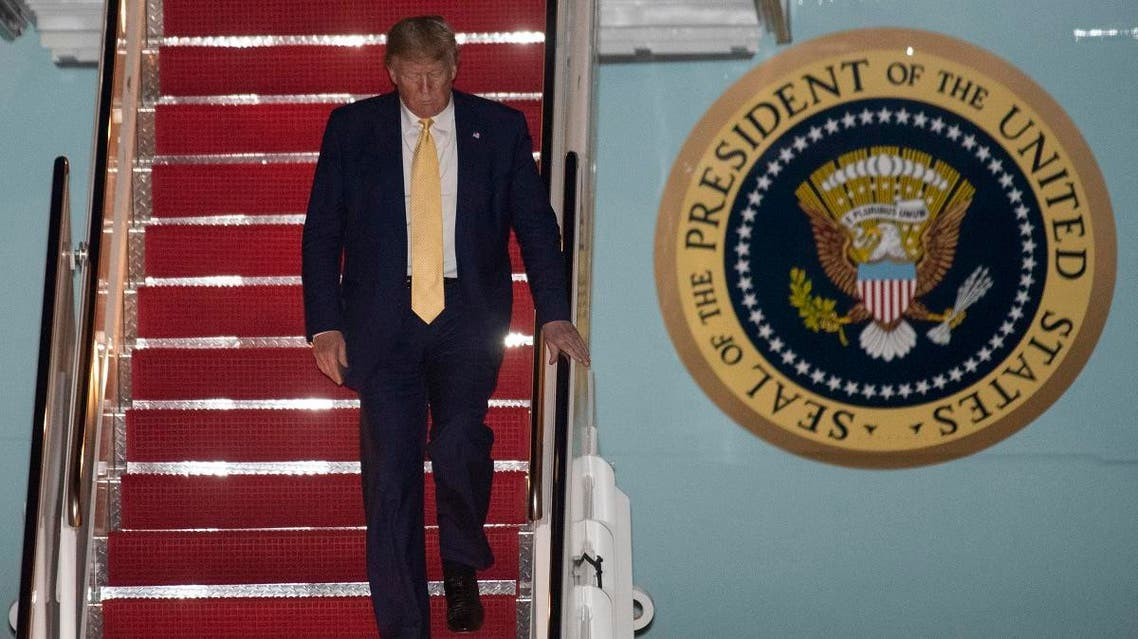 President Donald Trump departs Air Force One early on October 12, 2019, at the Andrews Air Force Base, Md., after returning from a campaign rally in Louisiana. (AP)