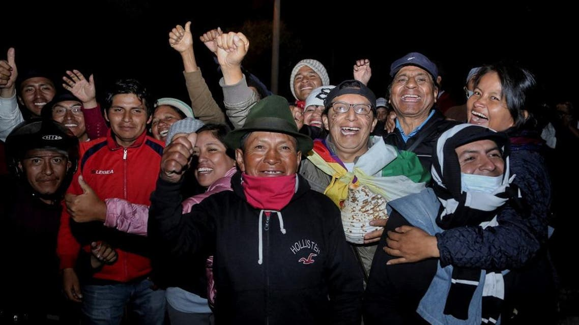 Indigenous people celebrate after a meeting with the Ecuadorean president in Quito on October 13, 2019, during which an agreement was reached to end violent protests. (AFP)