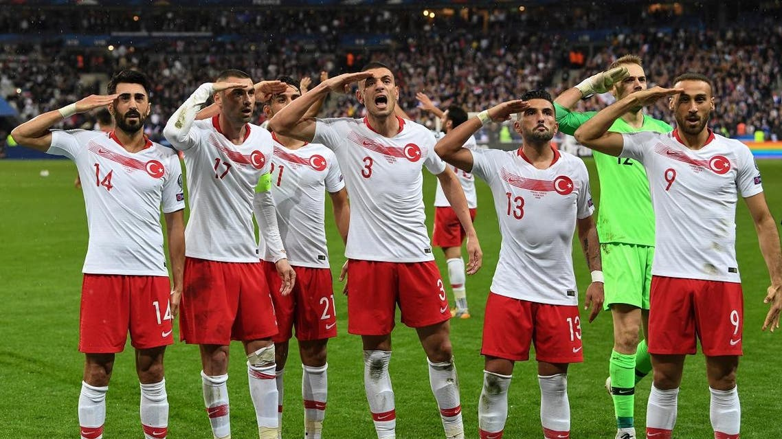 Turkish players salute at the end of the Euro 2020 Group H qualification football match between France and Turkey at the Stade de France in Saint-Denis, outside Paris on October 14, 2019. (AFP)