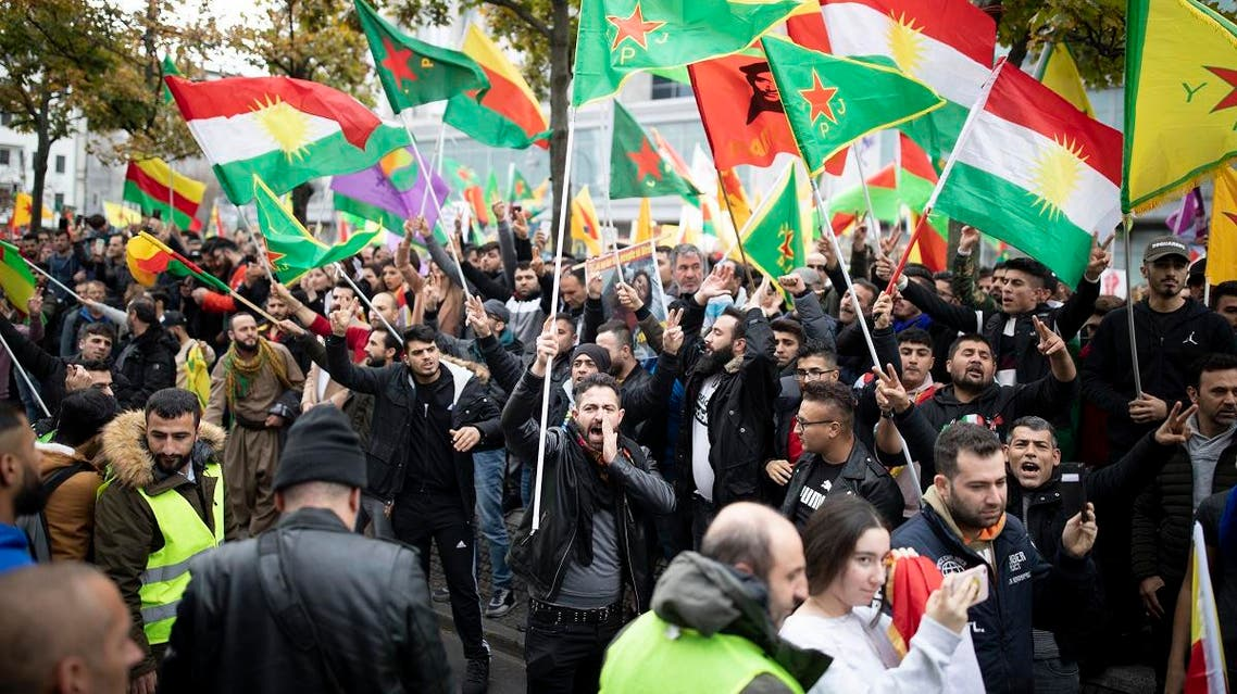 Protesters wave flags as they take part in a rally in Berlin, on October 12, 2019 to support Kurdish militants as Turkey kept up its assault on Kurdish-held border towns in northeastern Syria on the fourth day of an offensive that is drawing growing international condemnation, even from Washington. (AFP)