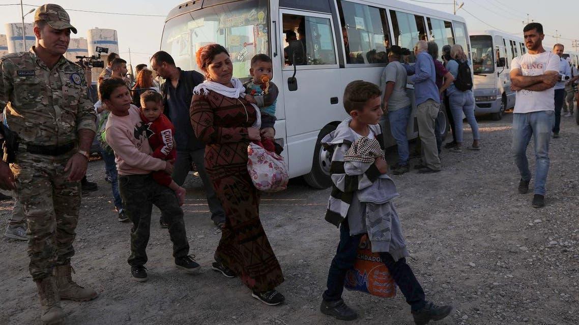 Syrians Kurds are pictured upon arriving at the Bardarash camp, near the Kurdish city of Dohuk, in Iraq's autonomous Kurdish region, on October 16, 2019. (AFP)