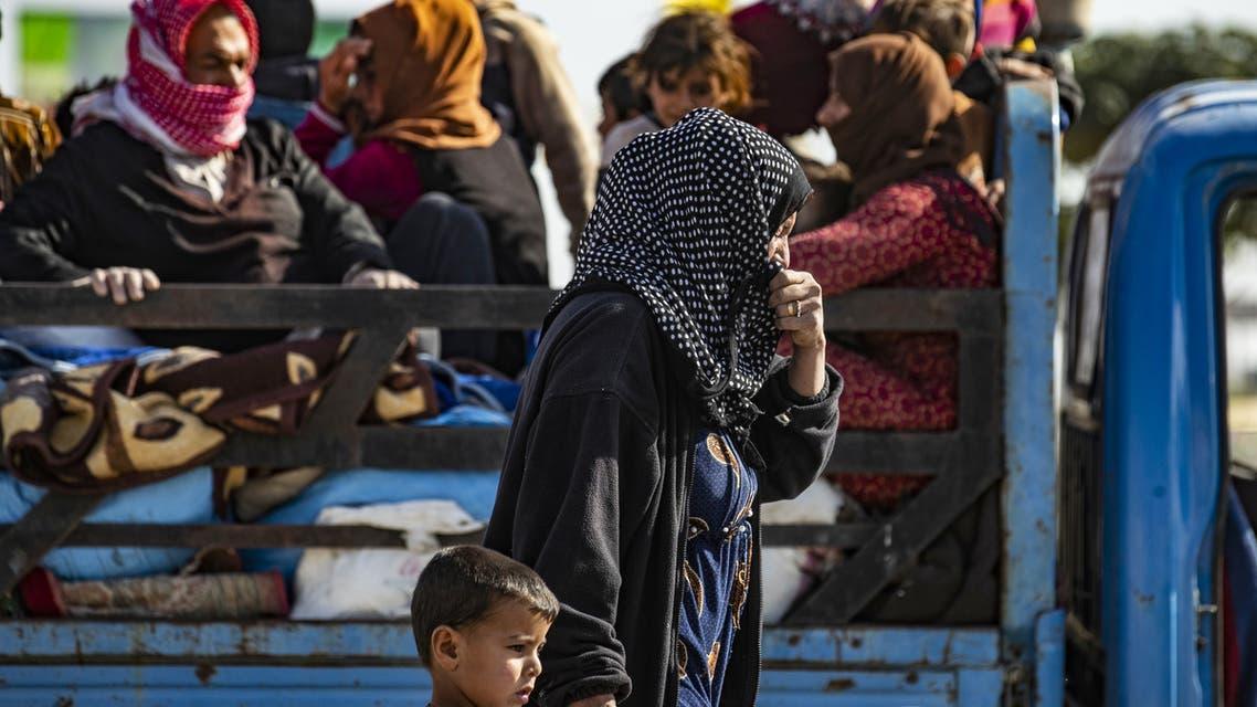 Syrian families fleeing the battle zone between Turkey AND Kurdish  town of Ras al Ain SYRIA Turkey October 15 2019 AFP