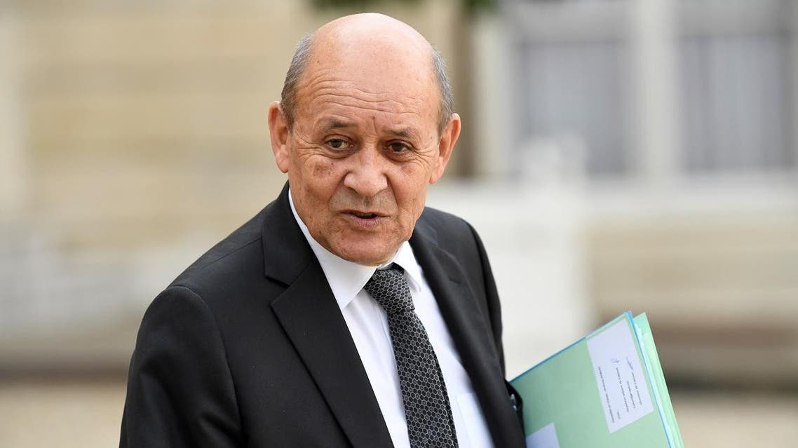 France's Foreign Minister Jean-Yves Le Drian gestures as he leaves The Elysee Presidential Palace in Paris on September 30, 2019. (AFP)