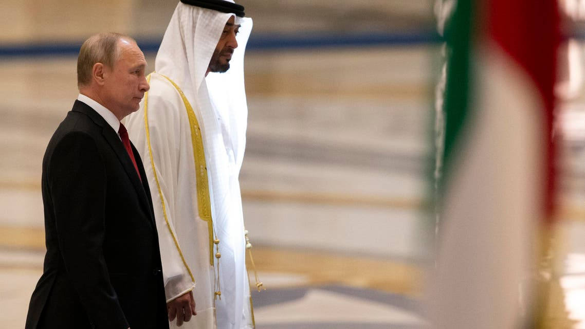 Russian President Vladimir Putin, left, and Abu Dhabi Crown Prince Mohamed bin Zayed al-Nahyan attend the official welcome ceremony in Abu Dhabi, United Arab Emirates, Tuesday, Oct. 15, 2019. (AP Photo/Alexander Zemlianichenko, Pool)