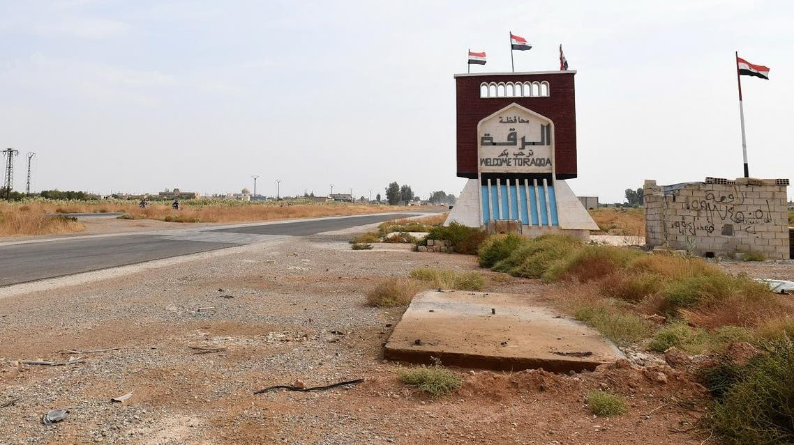 A sign indicating the beginning of the northern Syrian province of Raqa is pictured on October 16, 2019 as Syrian regime forces (unseen) deployed there at the Tabqa air base. (AFP)
