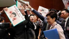Hong Kong leader abandons policy speech as lawmakers disrupt session