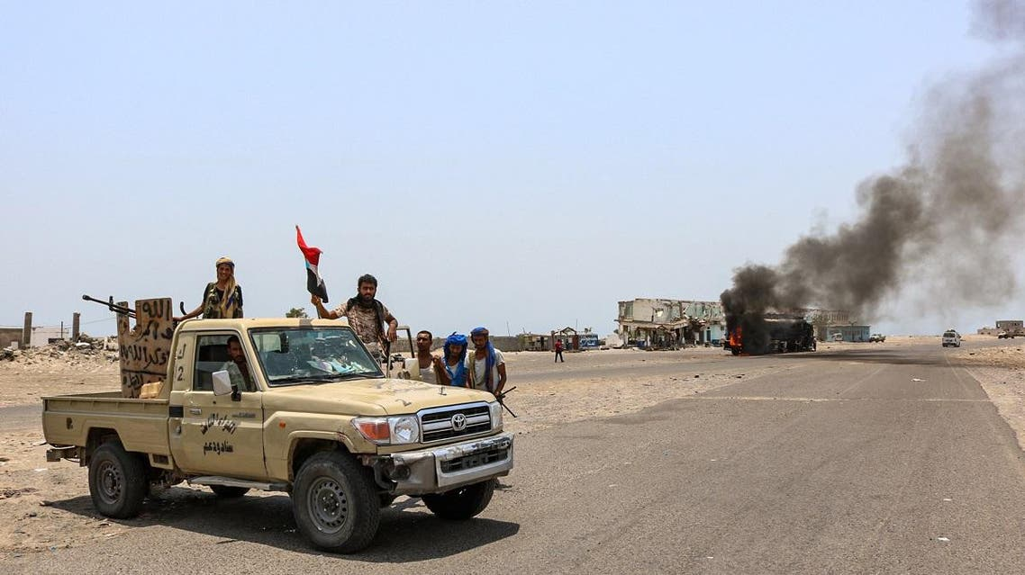 Fighters of the UAE-trained Security Belt Force, dominated by members of the Southern Transitional Council (STC) which seeks independence for south Yemen, gather at the Fayush-Alam crossroads on the eastern entrance Aden from the Abyan province in southern Yemen on August 30, 2019. (AFP)
