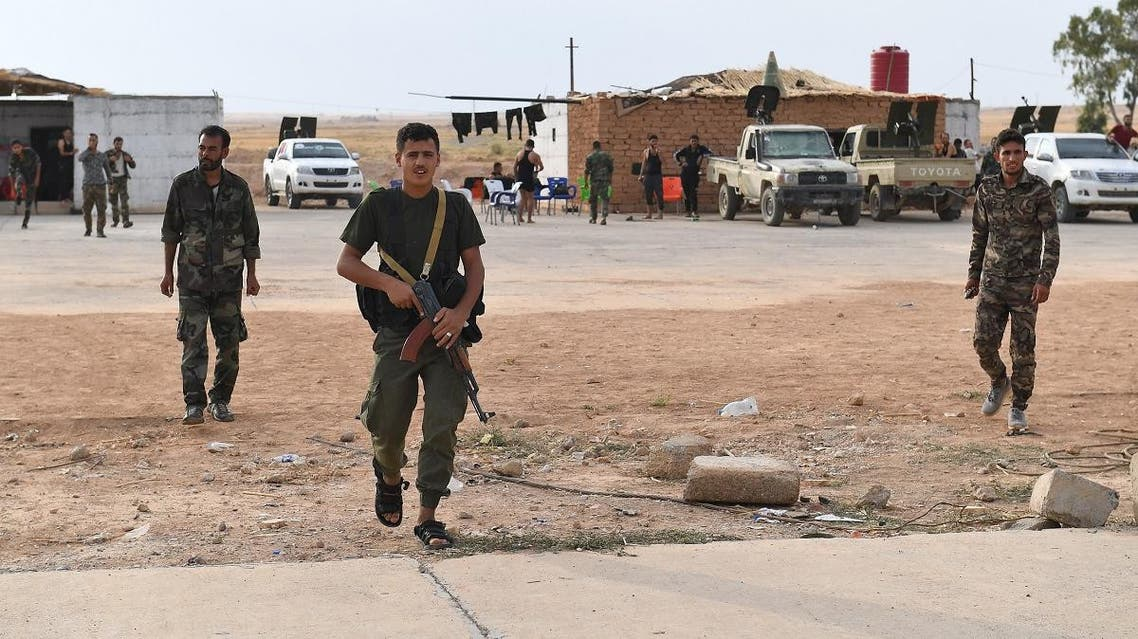 Syrian government forces gather at Tabqa air base in the northern Raqqa. (AFP)