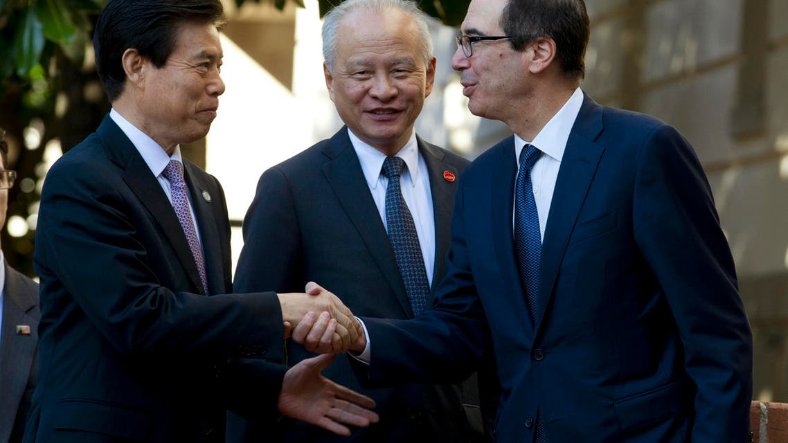 Treasury Secretary Steven Mnuchin shake hands with Chinese Commerce Minister Zhong Shan, left, before a minister-level trade meeting at the Office of the United States Trade Representative in Washington, Friday, Oct. 11, 2019. (AP Photo/Jose Luis Magana)