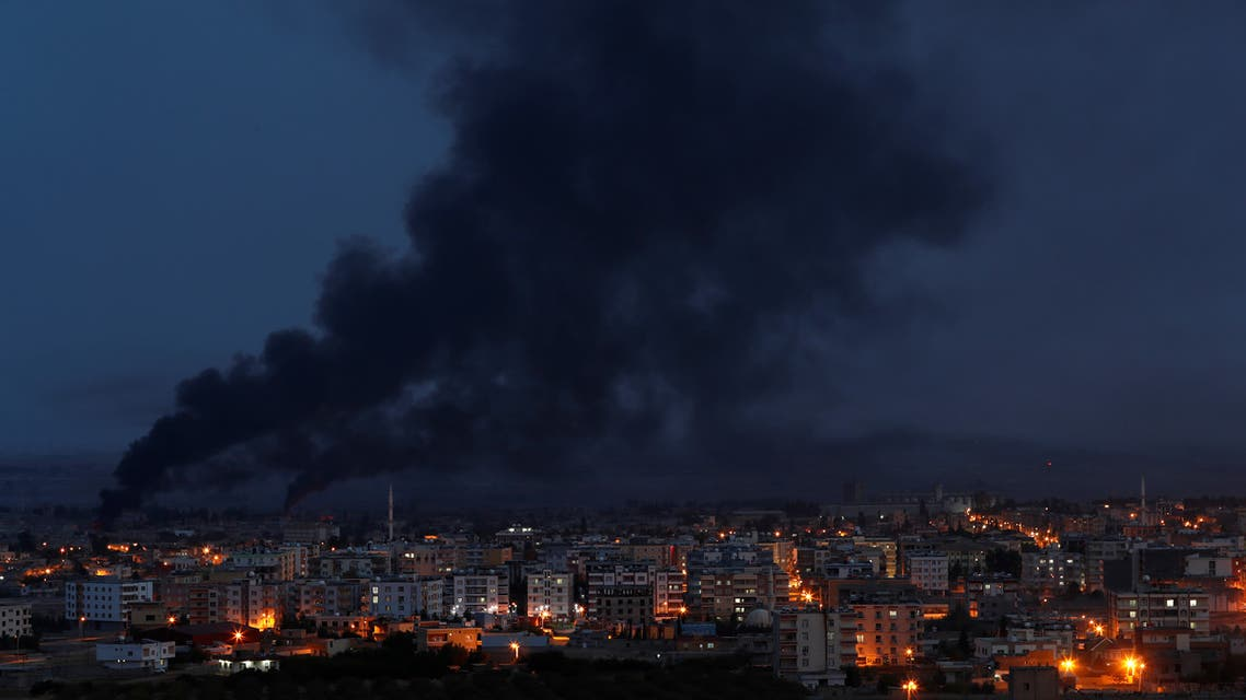 Smoke rises over the Syria town of Ras al Ain October 16 2019 REUTERS