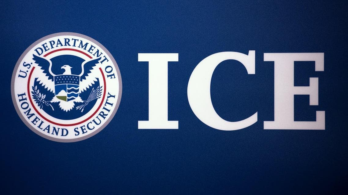 The Immigration and Customs Enforcement (ICE) seal is seen before a press conference discussing ongoing enforcement efforts to combat human smuggling along the Southwest border of the United States, July 22, 2014 at ICE headquarters in Washington, DC. AFP