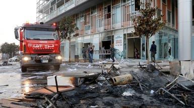 """قصة """"الضريبة"""" التي أشعلت لبنان.. المواطن يدفع مرتين!"""