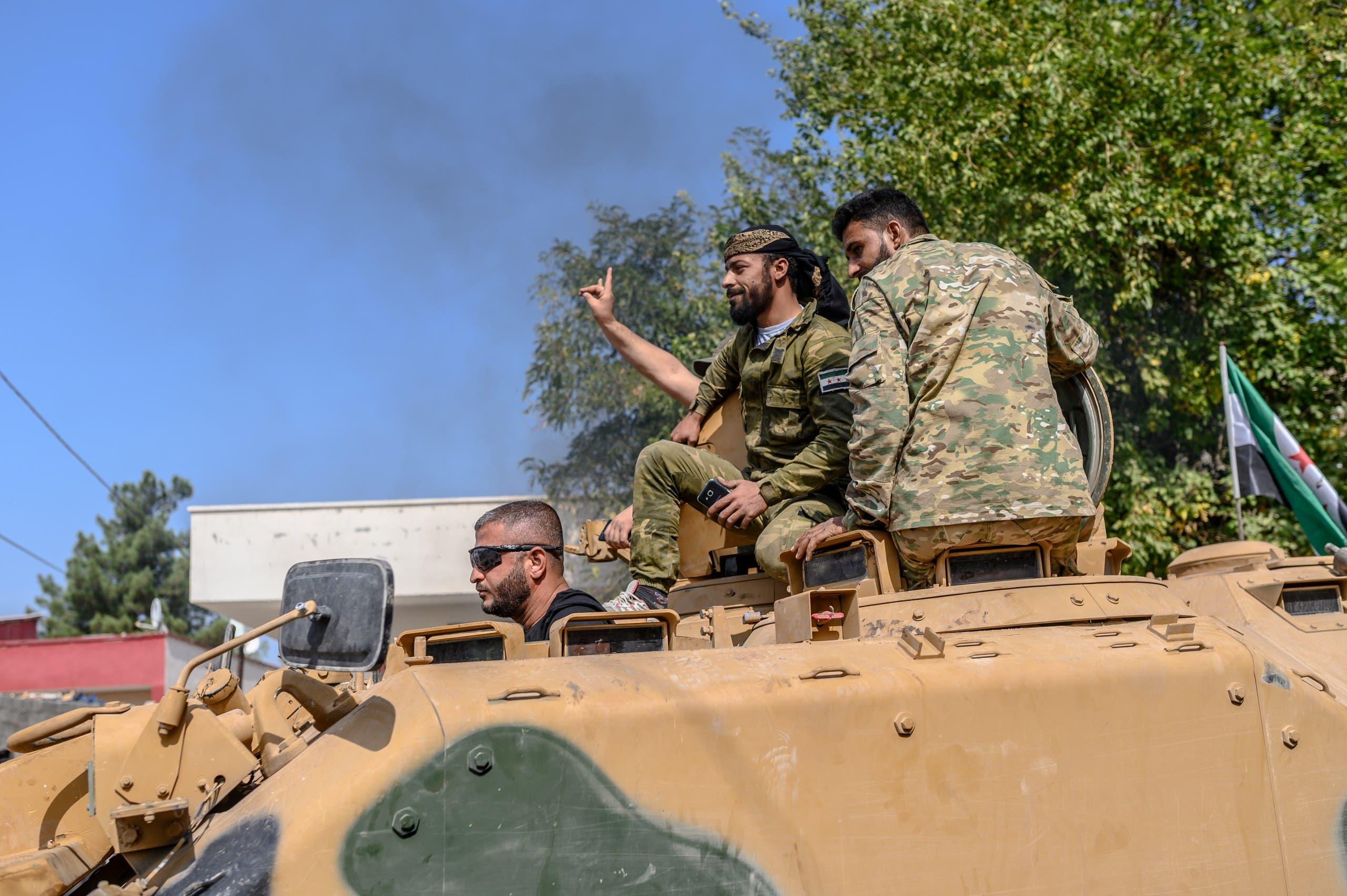- فرانس برس)عناصر من فصائل مسلحة مدعومة من أنقرة في تل أبيض شمال سوريا(18 أكتوبر