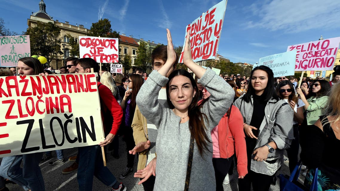 A woman claps her hands during a demonstration in Zagreb on October 19, 2019 to protest against a judiciary system that women say is failing to protect them. (Reuters)