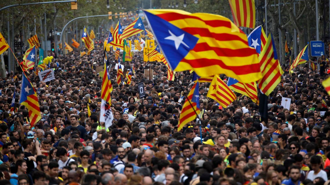 Protestors wave Estelada pro-independence flags during a demonstration in Barcelona, Spain, Friday, Oct. 18, 2019.
