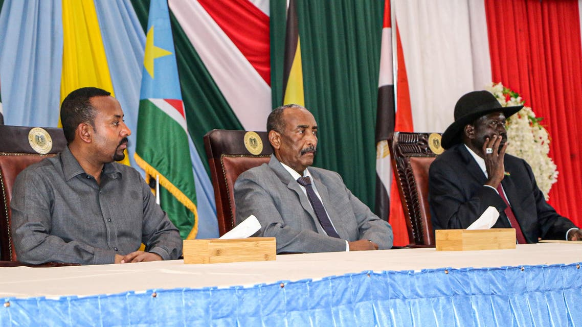 From Left: Ethiopian Prime Minister Abiy Ahmed, President of Sudanese Transitional Council General Abdel Fattah al-Burhan and President of South Sudan Salva Kiir attend a meeting to endorse the peace talks between Sudan's government and rebel leaders in Juba, South Sudan, on October 14, 2019. (AFP)