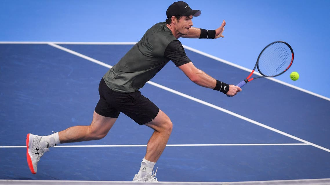Britain's Andy Murray returns a shot during a tennis match against Uruguay's Pablo Cuevas, in the second round of the men's singles tournament at the European Open ATP Antwerp, on October 17, 2019, in Antwerp. (AFP)