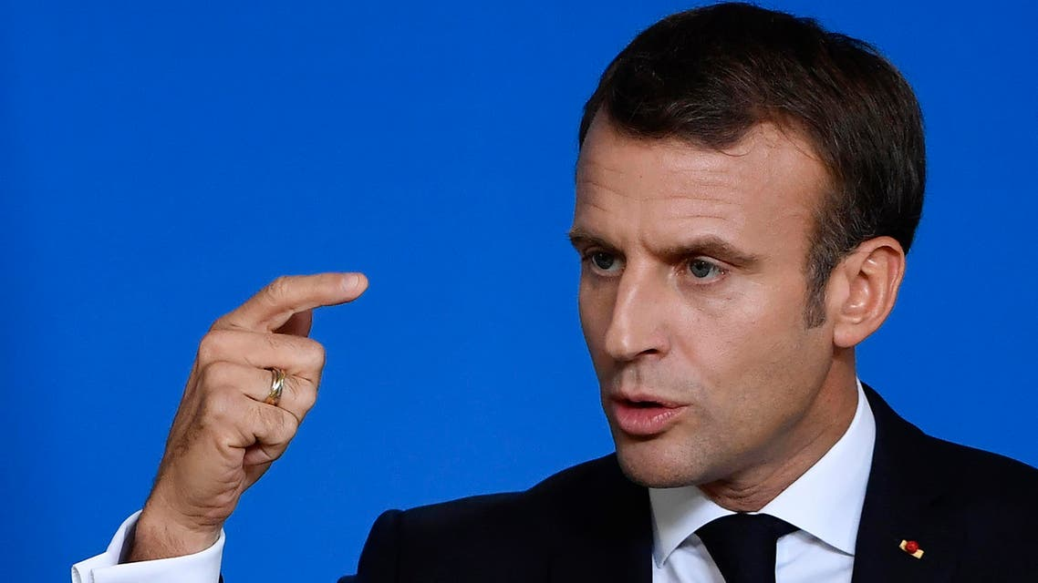 France's President Emmanuel Macron gestures at a press conference during a European Union Summit at European Union Headquarters in Brussels on October 18, 2019. (AFP)