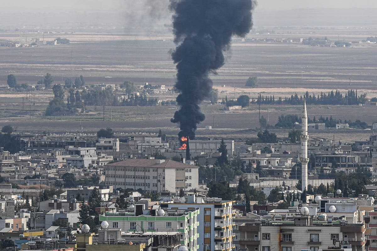This picture taken on October 18, 2019 from the Turkish side of the border at Ceylanpinar district in Sanliurfa shows fire and smoke rising from the Syrian town of Ras al-Ain on the first week of Turkey's military operation against Kurdish forces. (AFP)