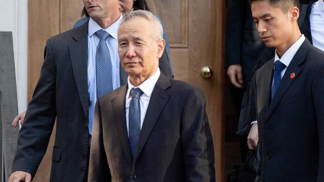 Chinese Vice Premier Liu He (C) departs during trade talks with the US Secretary of Treasury and US Trade Representative at the office of the US Trade Representative in Washington, DC, October 10, 2019. (AFP)
