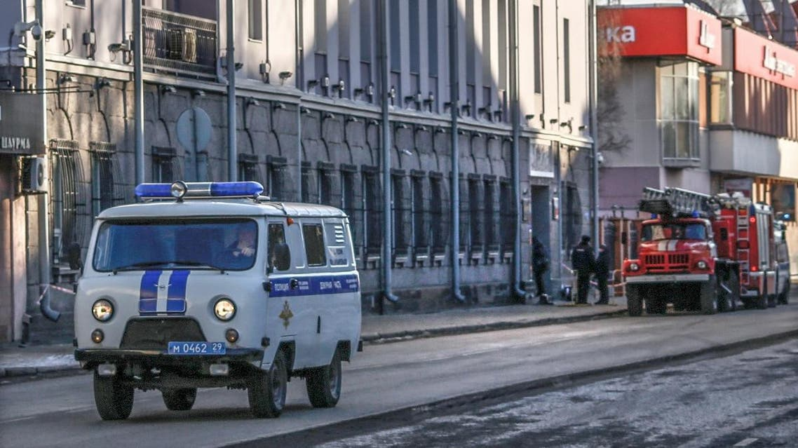 Russian police car and fire-engines are seen near a building housing the FSB security service in Arkhangelsk on October 31, 2018, after an explosive device went off inside the building. (AFP)