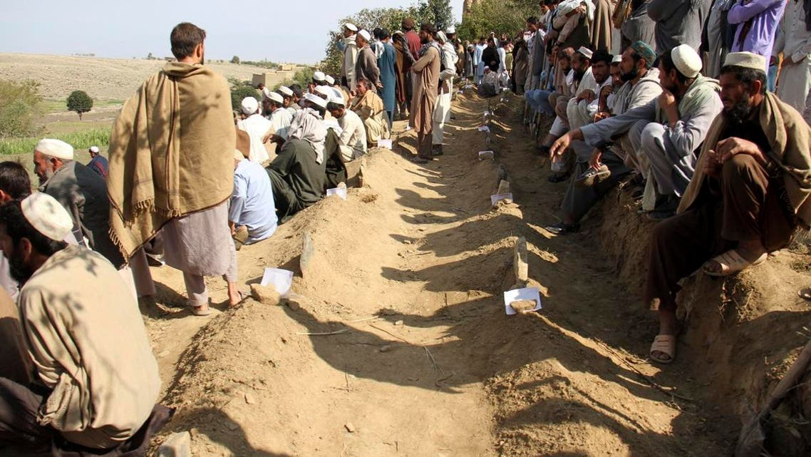 Afghan men bury victims of Friday's deadly bomb blast in the mosque in the village of Jodari at Haskamena district of Jalalabad east of Kabul, Afghanistan, Saturday, Oct. 19, 2019. (AP)