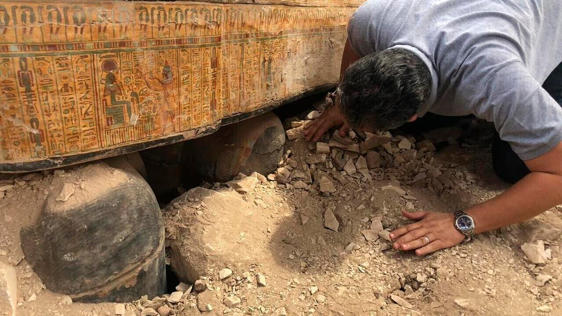 Oct. 15, 2019 file photo provided by the Egyptian Ministry of Antiquities shows Egyptian Minister of Antiquities Khaled el-Anany looking at recently discovered ancient colored coffins with inscriptions and paintings, in the southern city of Luxor, Egypt. (AP)