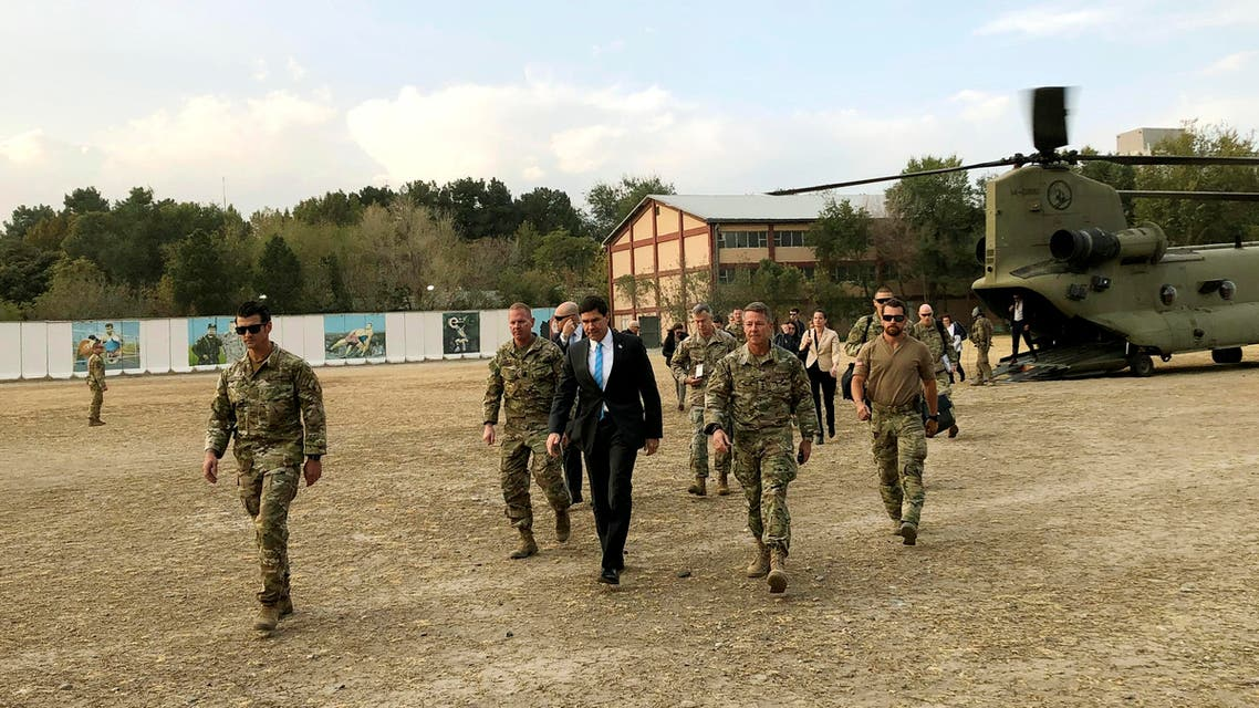 U.S. Defense Secretary Mark Esper, center, walks Gen. Scott Miller, right, chief of the U.S.-led coalition in Afghanistan, at the U.S. military headquarters in Kabul, Afghanistan, Sunday, Oct. 20, 2019.  (AP)