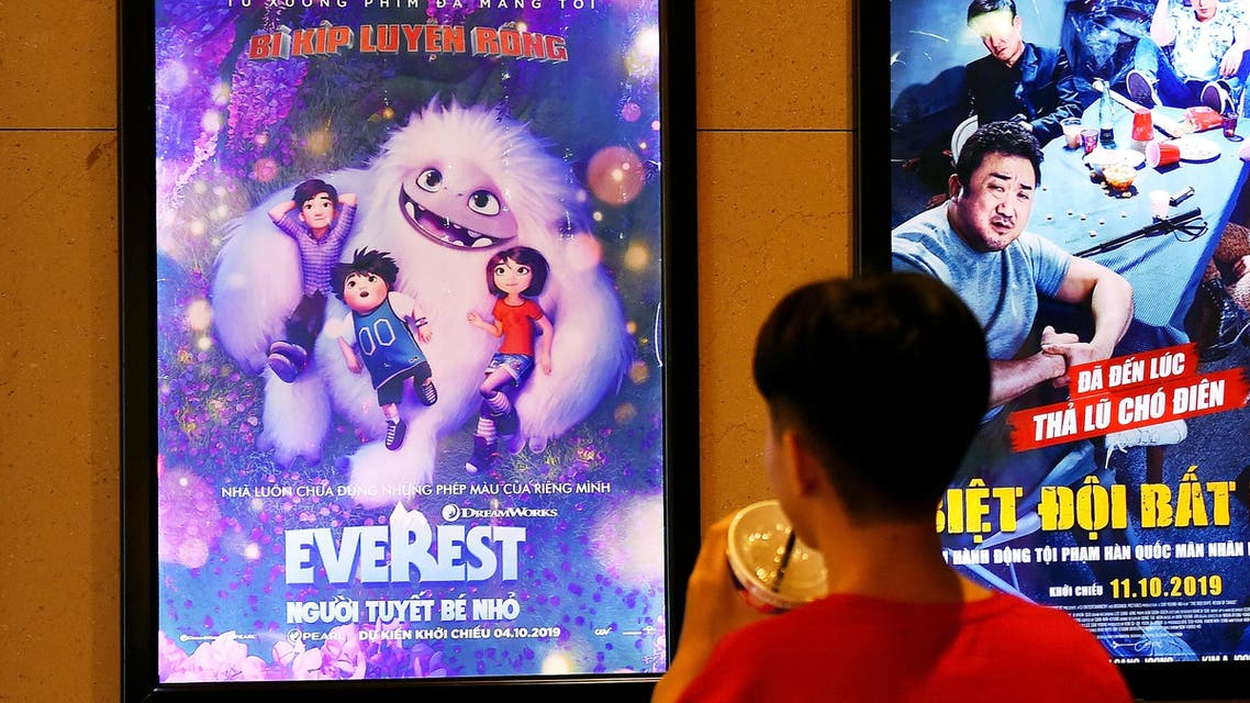 """A boy looks at a poster for the animated movie """"Everest Nguoi Tuyet Be Nho"""", also known as """"Abominable"""", at a movie theatre in Hanoi on October 14, 2019. (AFP)"""